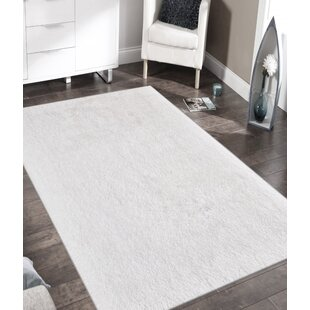 Buy luxury Doster Solid White Area Rug By Ebern Designs