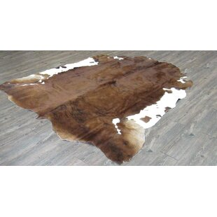 Online Reviews Williamstown Hand-Woven Cowhide Solid Brown/White Area Rug By Loon Peak