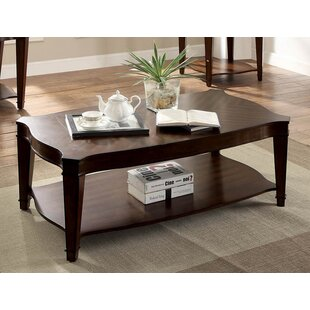 Recio Curved Coffee Table by Charlton Home