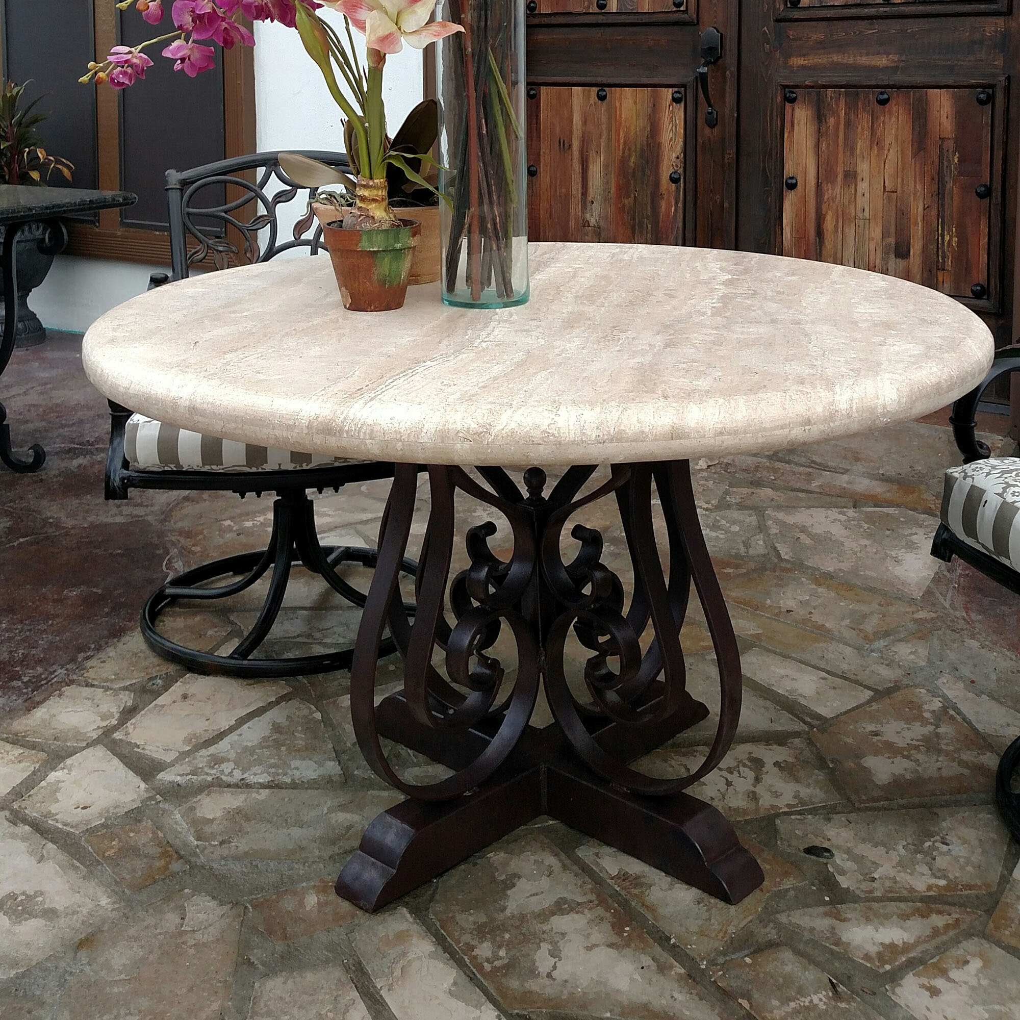 Mexports By Susana Molina Rustic Elegant Dining Table With Wrought Iron Legs And A 48 Round Travertine Top Wayfair