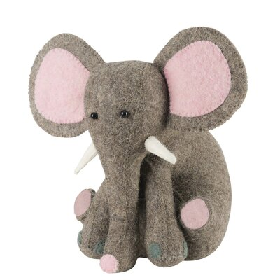 An elephant never forgets; in this darling elephant\'s case, it never forgets a very important job-- to prop open doors! And they\'ll have fun while he\'s at it, with little trunk raised in a playful gesture. Also a very capable bookend. Precious in the nursery, playroom, and as a baby shower or baby birthday gift.Arcadia Home designs are handmade. Each design is as unique as the artisan who creates it.Arcadia Home felt designs are hand-felted, hand appliqued, and lovingly created from 100% sustainable wool by artisans working in India. The facility where these pieces are produced is an award-winning model of sustainability, which runs on solar electricity, collects rainwater, and recycles water on-site. By collaborating with this artisan group, Arcadia Home is helping to preserve the tradition of felt making in the area, promote eco-friendly business, and provide fair and safe employment for hundreds of artisan felt-makers, sheepherders, and seamstresses.Our artisans are experts in their craft - creating the heirloom of tomorrow. Arcadia Home Color: Pink