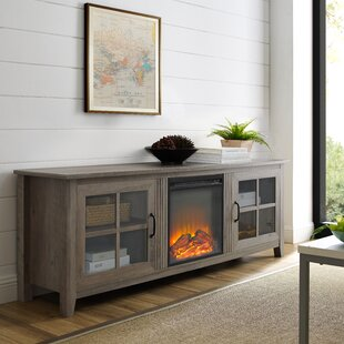 Purchase Daily TV Stand for TVs up to 70 with Fireplace ByCharlton Home