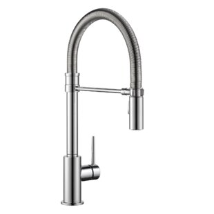 Review Trinsic Pull Down Single Handle Kitchen Faucet with MagnaTite® Docking and Diamond Seal Technology by Delta