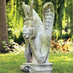 Gargoyles Spitting Statue