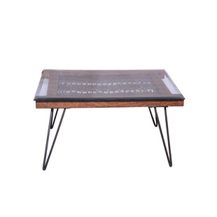Wells Coffee Table by Union Rustic