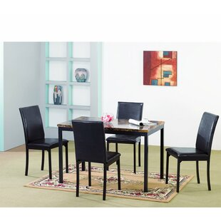 Della Dining Table by Ebern Designs Savings