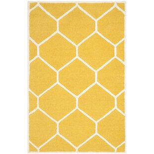Griffin Hand-Tufted Gold/Ivory Area Rug by Safavieh