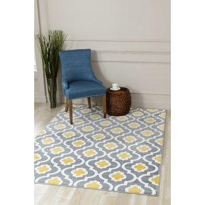 Tobis Yellow Indoor/Outdoor Area Rug