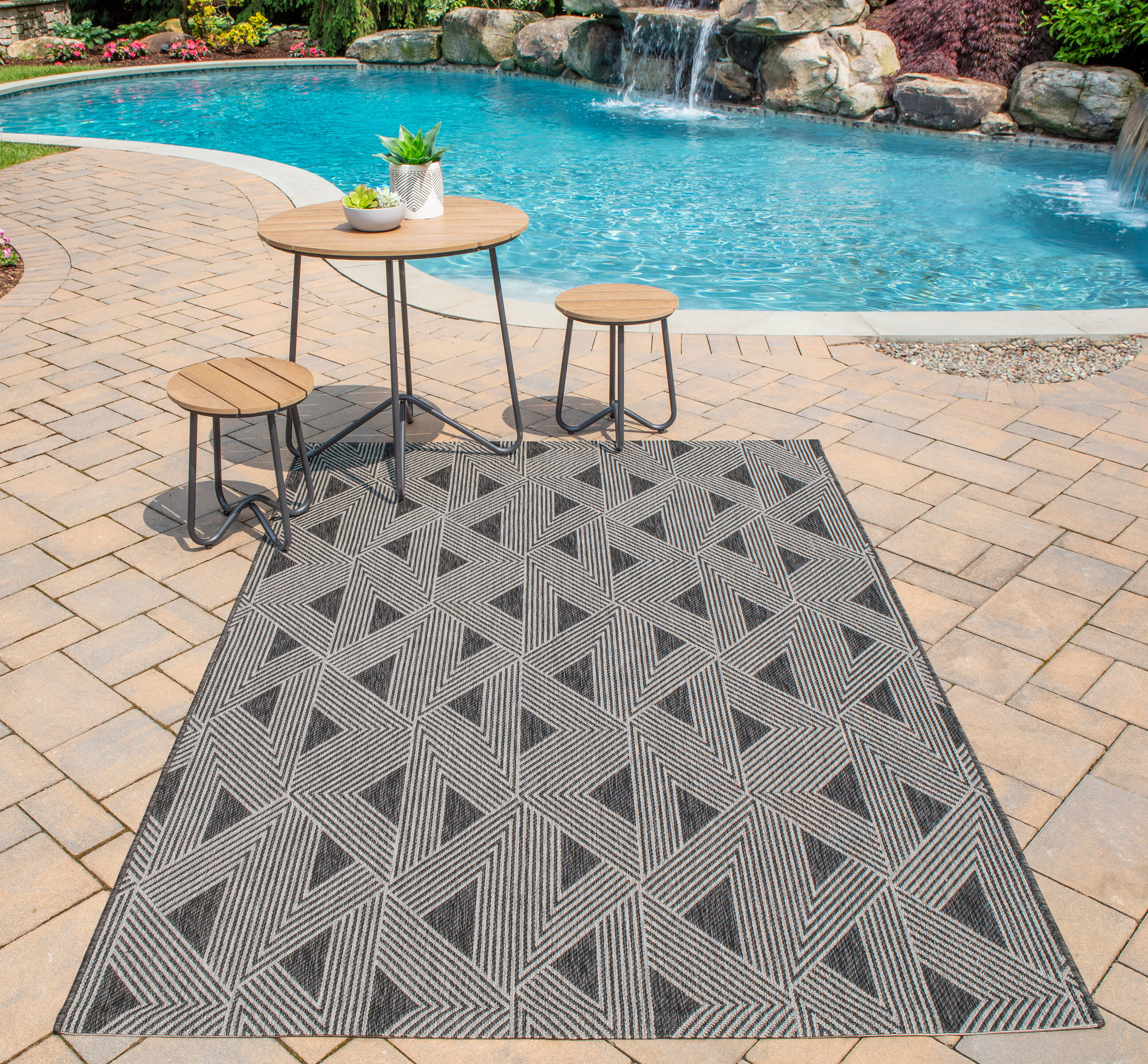 Picture of: Novogratz Sardinia Striped Charcoal Black Indoor Outdoor Area Rug Reviews