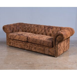https://secure.img1-fg.wfcdn.com/im/05476657/resize-h310-w310%5Ecompr-r85/6203/62037875/capone-leather-chesterfield-sofa.jpg