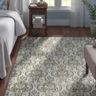 Peggie Ivory Damask Indoor/Outdoor Area Rug