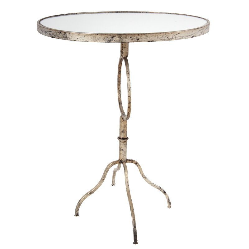 Nova End Table - this is the sexiest antiqued silver accent round table I have seen in a while! Look at those curvy legs! #antiquedsilver #sidetable #accenttable #tables #livingroom #silvertable #roundtable