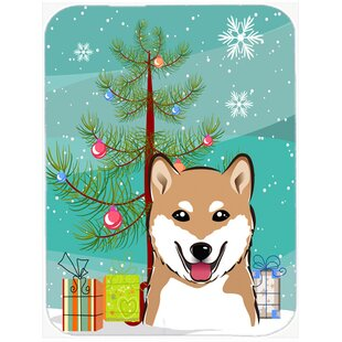 Under the Christmas Tree and Shiba Inu Glass Cutting Board By Caroline's Treasures
