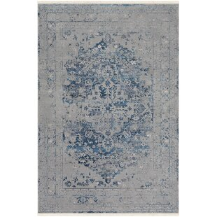 Elvis Distressed Gray Area Rug by Bungalow Rose