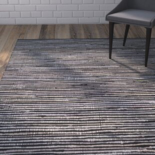 Where buy  Shatzer Hand-Woven Black Area Rug By Wrought Studio