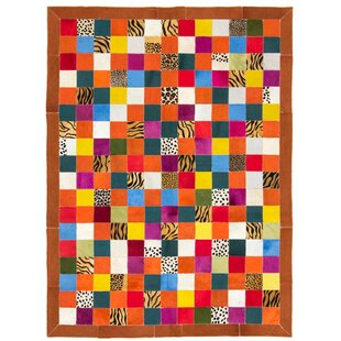 Siegel Handmade Flat-Woven Cowhide Orange/Yellow/Red Rug by World Menagerie