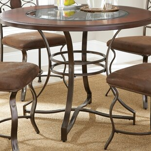 Wrought iron kitchen dining tables youll love dasia dining table workwithnaturefo