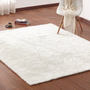 Find the perfect Christerfer Faux Fur White Area Rug By Everly Quinn