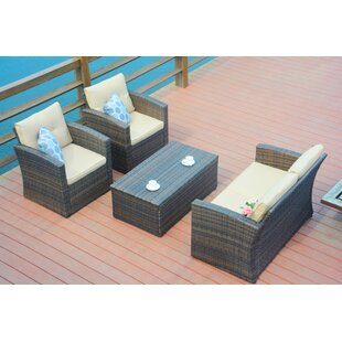 Michaelson 4 Piece Rattan Sofa Seating Group with Cushions