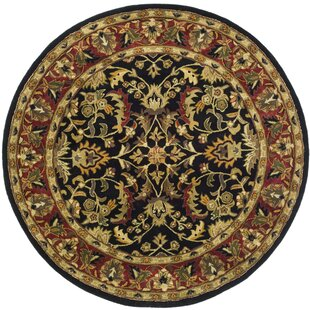 Cranmore Hand-Tufted Wool Black/Red/Green/Yellow Area Rug by Charlton Home