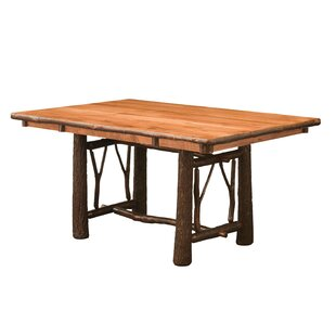 Quinney Twig Trestle Solid Wood Dining Table Loon Peak