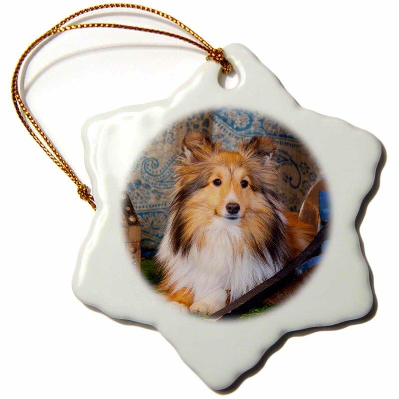 The Holiday Aisle Shetland Sheepdog Lying By A Wooden Wagon Mr Snowflake Holiday Shaped Ornament Wayfair