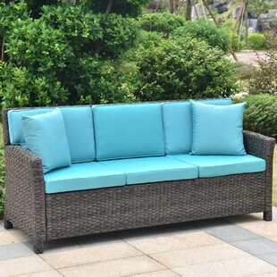 Deanna Resin Wicker Patio Sofa with Cushions by Red Barrel Studio