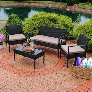 Waldrup 4 Piece Rattan Sofa Set with Cushions