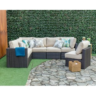 Sours Outdoor 7 Piece Sectional Seating Group with Cushions
