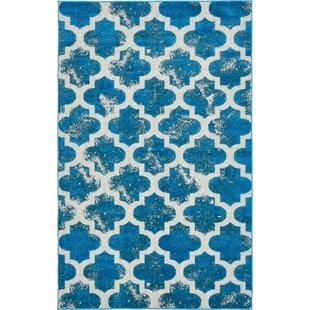 Sarno Turquoise Indoor/Outdoor Area Rug ByWrought Studio