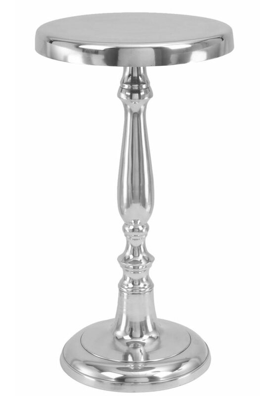 Michael Pedestal End Table is a petite silver toned metal accent table with round top