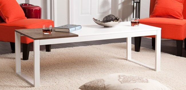 A Modern, White Coffee Table In A Living Room With Red Sofas