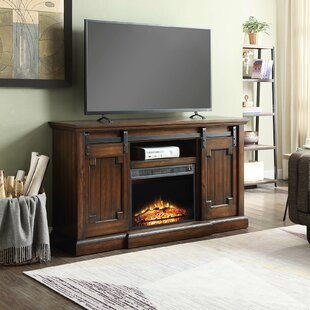 Claybrooks TV Stand for TVs up to 65 with Electric Fireplace By Gracie Oaks