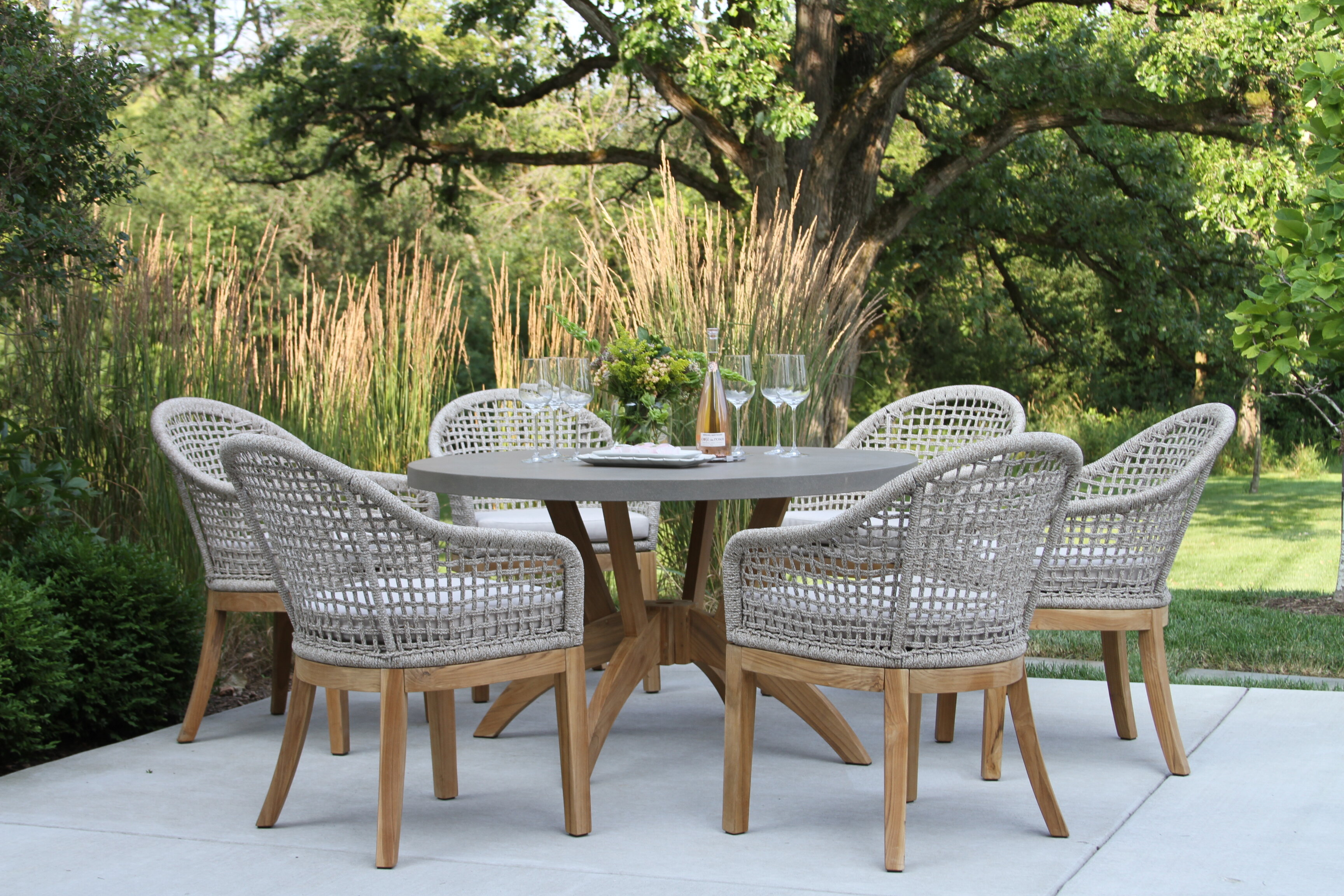 hayden round 6 person 52 long teak dining set with cushions