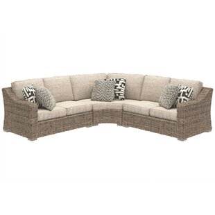 Suzan 3 Piece Rattan Sectional Seating Group with Cushions