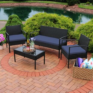 Waldrup 4 Piece Rattan Sofa Seating Group with Cushions