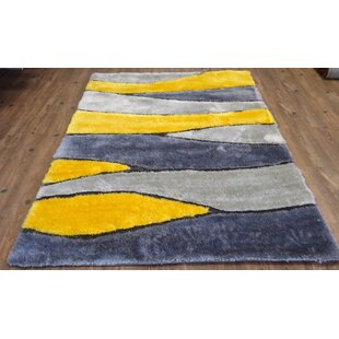 Comparison Hand-Tufted Gray/Yellow Area Rug By Rug Factory Plus