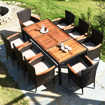 Odon Patio 9 Piece Dining Set With Cushions by Latitude Run Comparison