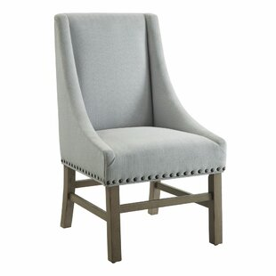 Renhold Wingback Upholstered Dining Chair..