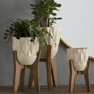 Ceramic Planters You'll | Wayfair on large plant pots for trees, large potted plants, natural spring decorative plant containers, large outdoor glazed pots,