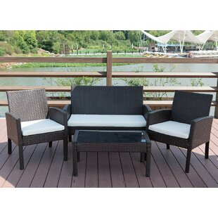 Simoneau 4 Piece Rattan Sofa Seating Group with Cushions