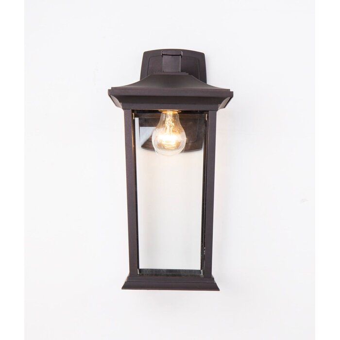 This Modern Outdoor Wall Sconce Is In A Black Finish Of The Casing Ensure Traditional Look Metal Frame And Clear Gl Shade Provide Rich