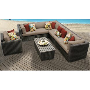 Mejia 8 Piece Outdoor Sectional Seating Group with Cushions