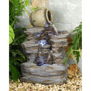 Wildon Home ® Resin Spilling Jug Cascading Fountain with LED Light