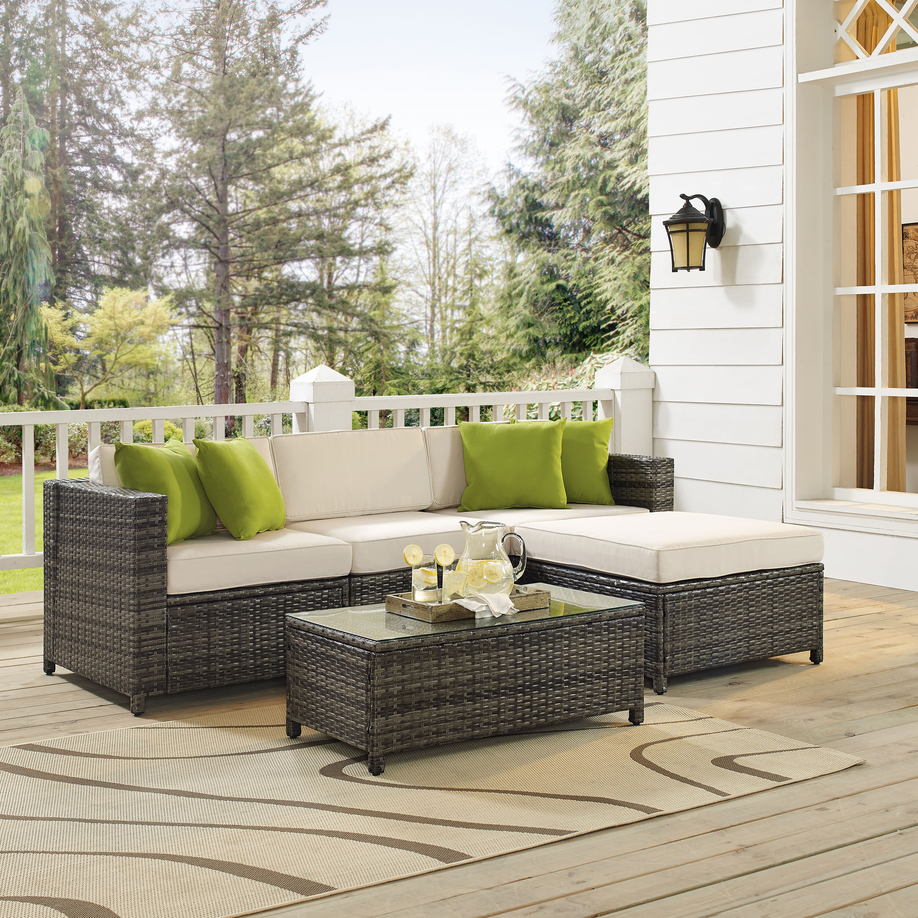 Carmelo 5 Piece Rattan Sectional Seating Group with Cushions
