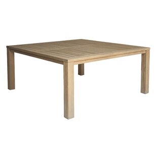 Rocha Solid Wood Dining Table by Rosecliff Heights