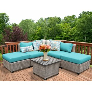 Meeks 6 Piece Rattan Sectional Seating Group with Cushions