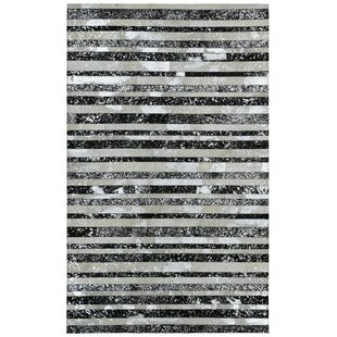 Find the perfect Sandford Hand-Woven Silver/Black Area Rug By Ivy Bronx