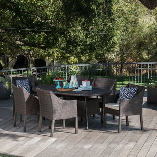 Ivy Bronx Arant Outdoor Wicker 7 Piece Dining Set with Cushions