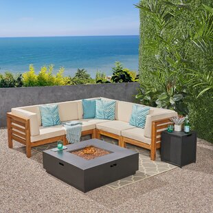 Maxwell Outdoor 7 Piece Sectional Seating Group with Cushions